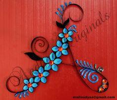 Simple quilled monograms by aadya originals