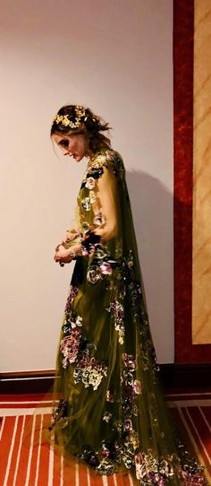 Olivia stuns in a Valentino number, complete with a cape and floral detail.