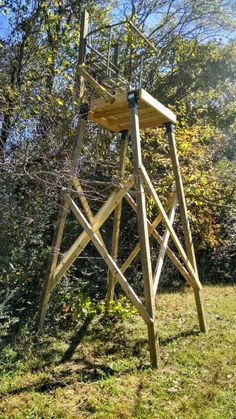 Elevated hunt'n stand with the upper section of an old 2 man ladder stand attached to the platforn