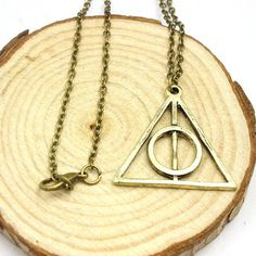 The Deathly Hallows consist the Elder Wand, the Resurrection Stone and the Cloak of Invisibility. The symbol was actually mistakenly adopted one of dark Wizardry ever since Gellert Grindelwald used it