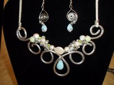 genuine gems..sterling and pearl accents...pale blue and green stones