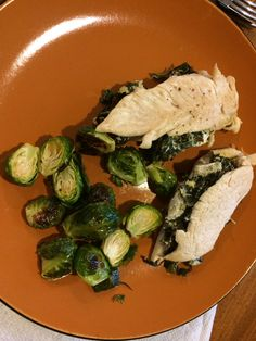 Chicken stuffed with sautéed spinach and artichokes.  Served with a side of roasted brussel sprouts.  Just used olive oil and garlic in the sautée mix.  Sprinkled chicken with sea salt and pepper.  I also mixed a couple table spoons of plain Greek yogurt to make yo a little creamy.  You can skip the yogurt...depending on if you use dairy.  I try to stay away from dairy, but this was a little treat.