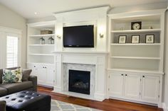 White built-ins around fireplace in family room with updated brick/tile and large white mantel. TV mounted above fireplace. Bookshelves Around Fireplace, Tv Over Fireplace, Fireplace Built Ins, Home Fireplace, Bookshelves Built In, Fireplace Remodel, Fireplace Surrounds, Fireplace Design, Fireplace Ideas