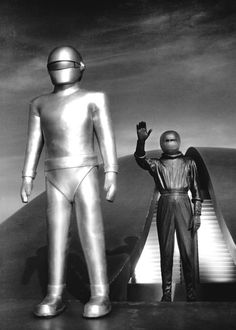 A humanoid named Klaatu (Michael Rennie) exits the aircraft, along with his metallic robot named Gort (Lock Martin). Sci Fi Genre, Sci Fi Films, Frances Bavier, Color In Film, The Iron Giant, Turner Classic Movies, Adventure Movies, Creature Feature, Ringo Starr