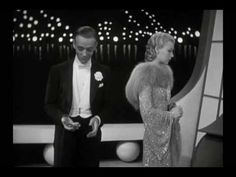 """Ginger & Fred #13) """"Let's Face the Music and Dance"""" from """"Follow the Fleet."""" One of their best, it's a mini film in itself. Lucille Ball can be seen as a blonde in the beginning behind Astaire. By this point, Rogers had really honed her skills as a dancer. Definitely a high point in their partnership, this number was later paid tribute to in """"Pennies from Heaven"""" with Bernadette Peters and Steve Martin."""