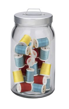For a creative way to store you sewing materials why not use a clear glass jar?