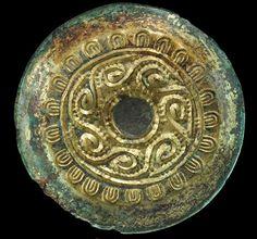 ANGLO- SAXON 'RUNNING SPIRALS' SAUCER BROOCH, ca. 6th century A.D.