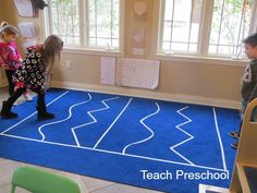 Tape lines on the floor by Teach Preschool