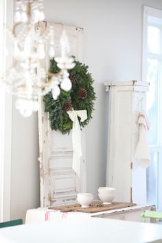 Love the pine wreath, pine cones and white bow. I'd make the bow gold or red
