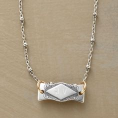 """PERSONALIZED HEIRLOOM NECKLACE--A personalized I.D. tag necklace handcrafted to recall Victorian jewels, its delicate cartouche I.D. tag flanked by scrolled etchings and suspended from 14kt goldfilled jump rings. Cultured freshwater pearls at lobster clasps. Made in USA of sterling silver. Personalized with up to three uppercase block initials (letters only, no special characters or symbols). 16""""L, 5/8"""" x 1/4"""" tag."""