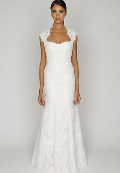 Monique Lhuillier - BL1210 - Gown features open back. Silhouette: Fit-N-Flare Neckline: Sweetheart   Gown Length: Floor  Train Style: Attached  Train Length: Sweep  Sleeve Style: Cap  Fabric: Reembroidered Lace, Chantilly Lace  Color: Ivory