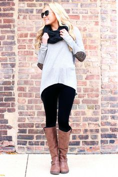 Adorable fall outfit with long sleeve with elbow patches, black pants, boots, and a scarf