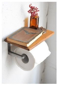 Cute idea. For resting phone, small book, some flowers.
