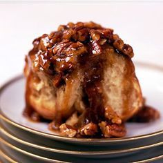 These old-fashioned extra-gooey sticky buns are topped with pecans and a cinnamon-caramel glaze.-I'd do it without the pecans