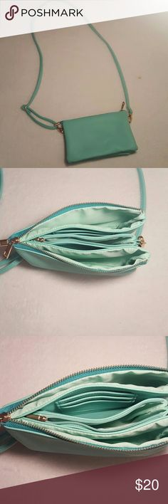 Teal Crossbody Teal Crossbody with multiple pockets and six credit card slots. Great Crossbody and barley used! Come from a smoke free home!! ?? Bags Crossbody Bags