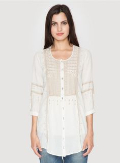 PIPER PEPLUM TUNIC cream cotton tunic top with a tan needlepoint embroidery design along the front, back, and ¾ length sleeves