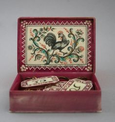 "One of a set of four counter boxes, French 1720-1730  ""Mariaval le Jeune was an engraver on ivory in Rouen and in Paris in the early to mid 18th century. He designed the card game Reversino (Reversis) in which the object is to avoid winning tricks. This set of four boxes are probably intended for this game."""