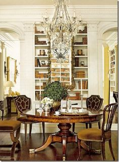 its a lovely room, would prefer some color in rear of the book shelves or mirror and ceiling tones,  the chair s are marvelous,   Jared Viar The Design Guy!