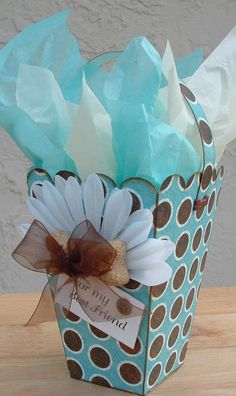 Darling paper gift basket in aqua and brown!!! Bebe'!!! Love the white petal trim!!!