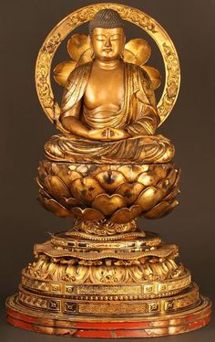 Image from http://www.antiques.com/vendor_item_images/ori__1741650683_1078606_Museum_Quality_Masterpiece_of_18th_C_Buddhist_Sculpture.jpg.