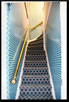 Like the pattern on pattern, both in blues.  Not the gold handrail, though.