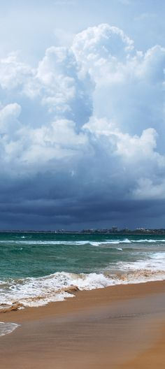 Storm clouds over the Sunshine Coast towns of Mooloolaba, and Maroochydore. Seen from Twin Waters Resort Beach.