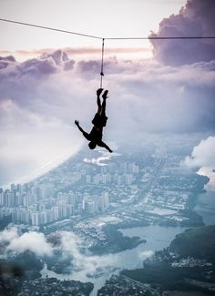 Pedra da Gavea highline above Rio de Janeiro. Ziplining upside down is probably the most fun thing ever.