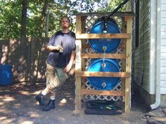 """2"" 55 gallon blue plastic water barrel rainwater collection system.  http://www.instructables.com/id/How-to-build-a-rain-water-collector/"