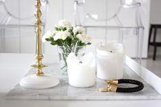 homevialaura | Gauhar | gauharshop.com | Scandinaviaform | candlestick | brass | gold | white flowers | marble | Reiss bracelet