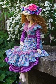 Lovely free pattern for country ruffle dress. Larger than barbie, but could be modified to fit.