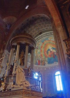 Milan (Italy): Altar and aps of the San Simpliciano Basilica. To point out the great fresco, partially hidden by the later too large altar.