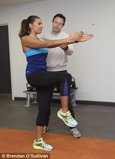James gets Helen to stand on one leg and lift her knee up. Then she has to swing it back and lean forwards