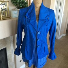 The Most Gorgeous Blue Lightweight Jacket!! This is another jacket from Chico's. I'm in love with the color and the runching at the wrists of the sleeve. I wish this still fit me!! It looks fantastic with so many things!! The fabric is 75% Cotton, 19% Linen, and 6% Metallic. The lining is 100% Polyester. It's easy care too! Machine Wash and tumble dry. This is in Excellent condition! It is a Chico's size 0 designed to fit size 4/6. Chico's Jackets & Coats