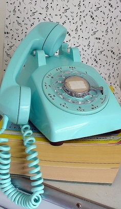 Vintage Aqua Blue Rotary Phone.  If your finger slipped, you have to start all over.  Sometimes it wasn't worth making that call.  You are also stuck in place, sitting on bed until call is done.