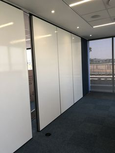 4 Variflex® Mobile Acoustic Partitions were installed in the ground floor meeting room area. This partition system permits flexible room layouts and subdivides meeting venues or conference facilities, only with an overhead track. Project: Accenture - Waterfall Park, Johannesburg - Aluglass Bautech