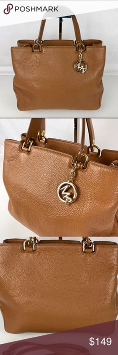 """Michael Kors Anabelle Large Top Zip Tote Condition:  Gently used. Exterior very good, interior has some marks and some light scratches on hardware  Beautifully crafted in refined leather, it features elegant double handles as well as an optional shoulder strap for hands-free portability. 21"""" to 23-3/4""""L detachable, adjustable shoulder strap Top zip closure Interior features center zip compartment, 1 zip pocket, 4 utility pockets and key clip 14"""" W x 10"""" H x 6"""" D   Thank you for your…"""