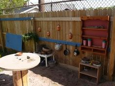 mud kitchen---she has made an AWESOME mud kitchen