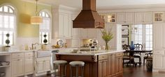 Manteo Maple Toasted Almond Glaze and Manteo Cherry Coffee Glaze by Thomasville Cabinetry