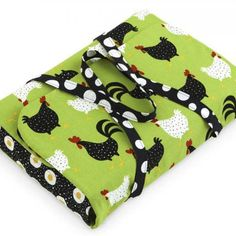 "casserole carrier  1/3 yard black-and-white polka dot (straps) 1 yard black egg print (pocket) 1 yard green chicken print (carrier) 1 yard insulated batting, such as Insul-Bright Water-soluble marking pen  Finished carrier: Holds a 13x9x2"" pan with lid"
