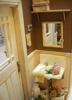 Mini bathroom with lots of details.