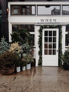 Beautiful plants outside a shop showroom, vintage modern, shop fronts, store design, Exterior Design, Interior And Exterior, San Myshuno, Terrazo, Exterior Front Doors, Shop Fronts, Cool Cafe, Wren, Amazing Flowers