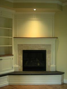 Residential, corner fireplace - smaller in the basement...Idea.