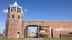 The guard towers and penitentiary walls at the former Lorton Prison site will remain intact after construction, save for a few adjustments such as additional entrances. Abandoned Prisons, Abandoned Places, Chincoteague Island, Creepy Pictures, Old Fort, U.s. States, Entrance, New Homes, Construction