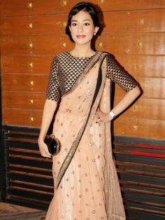 Amrita Rao looks pretty in this pastel sari. But what I like the best is her choli. Geometric designs are always in!