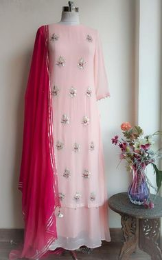 Powder Pink Gota Patti Double Layer Dress with Mukaish Dupatta Description: Gota patti and zardozi handwork motifs on the front Double layer floor length pattern… Indian Designer Suits, Designer Kurtis, Designer Dresses, Stylish Dresses, Simple Dresses, Fashion Dresses, Layered Dresses, Nice Dresses, Indian Gowns Dresses