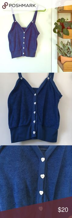 Vintage Blue Terry Cloth Crop Top w/ Heart Buttons The perfect worn in vintage crop top. Super soft and breathable terry cloth fabric for those hot and humid summer nights. Some peeling and a couple of small snags shown in photos. Still a rare find! Size M but could fit small. Vintage Tops Crop Tops