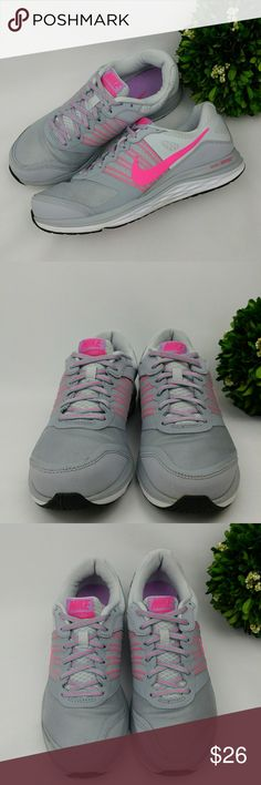 Nike Dual Fusion X womens athletic shoes Nike Dual Fusion X womens athletic shoes Grey/ pink/ purple/white/black colors Have been washed and sanitized.  Theres some signs of wear scuffs,stains, and the nike logo on the inner side of the right shoe peeled off. Size 9 26 cm Nike Shoes Athletic Shoes