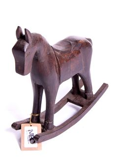 Small hand crafted wood rocking horse.
