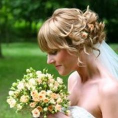loose curls with flower - bridal hair
