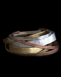 Hand beaten Gold, Silver, Bronze bangles--reminiscent of ancient Rome